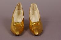 Women's gold kid pumps from the early twentieth century