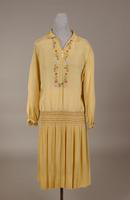 Yellow silk crepe dress from the 1920s