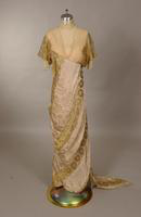 Evening gown with white net bodice over pink slip from the early twentieth century