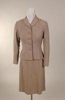 Women's suit in a fine brown, pink, blue, white, and black wool tweed from the 1950s