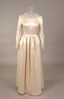 Ballgown of creamy white satin with jewel neckline from the 1970s