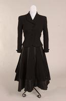 Women's two piece suit of black taffeta and  fine black wool from the late 1940s to mid 1950s