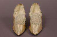 Women's eggshell satin wedding pumps from the 1920s