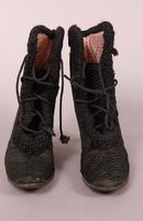 Women's black quilted satin boots from the early twentieth century