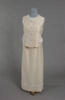 Two piece evening gown made of white alaskin from the 1960s