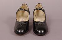 Women's shoes with black leather strap and black and silver buckle from the mid '20s to early '40s
