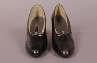 Women's black leather pumps with small bow of black and silver leather from the late '20s to early '40s