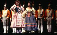 Samia Bahu as Giannetta, Janet Williams as Adina, with soldiers. Cast 1