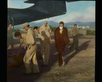 View of Soldiers, Planes, and a Man in Surgical Mask