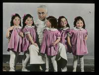 View of the Dionne Quintuplets Posing with Dr. A.R. Dafoe