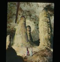 View of Two women and a Child Looking at Cave Formations