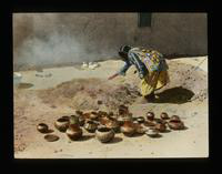 View of a Native American Woman Making Pottery