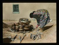 View of a Native American Woman Working with Clay Pots