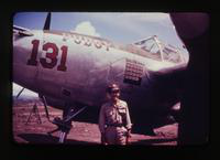 View of a Man in Uniform Next to Plane