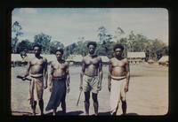 View of New Guinea Natives Holding Machetes
