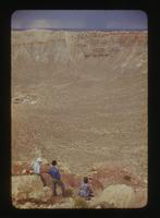 View of Three People Looking at a Meteor Crater in Flagstaff, Arizona