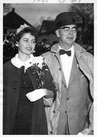 Carole Bloomfield is escorted by William B. Hall.