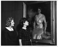 Virginia Makowski and Agnes Szczesny, look at a portrait of Mrs. Helen Jay.