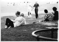 Students lounge on a grassy knoll at the 1965 Frosh Camp.