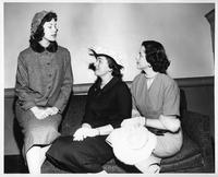 Three women, one of whom was Mrs. Norma Baker, the Mrs. Wayne State University 1957.