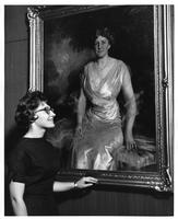 A student, Evelyn Ojanen (sp?), regards the portrait of Mrs. Helen Jay.