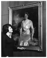 Student Alice Stafford regards the portrait of Mrs. Helen Jay