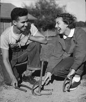 Two freshman, Leonard Gaba and Gail Labonte, both eighteen, play a game of horseshoes.