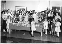 Il Circolo Italiano - Xmas Party for local orphans 1950. Each Child received a gift (toy) worth a $. [D]onated by local business concerns, shops, etc.