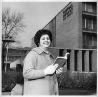 A portrait of Mrs. Sylvia Katz outside of the General Library.