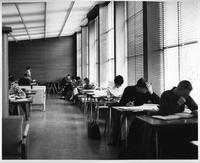 A group of students studying in the first floor lounge at State Hall.