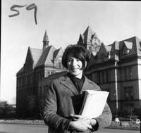 Portrait of a woman in front of Old main and another building.