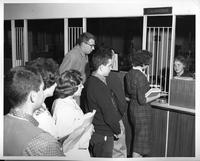 Students line up to pay their bill at the cashier's office.