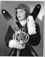 June Simes, the 1946 Homecoming Queen, poses with cross-country skis and poles.