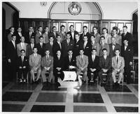 A group portrait of Alpha Kappa Psi Fraternity members.