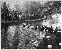 A tug-of-war across a stream on Belle Isle during the 1923 Frosh-Soph Games.