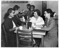 Members of the Panel of Americans are photographed having coffee.