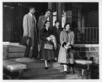 Members of the Panel of Americans are photographed leaving a building.