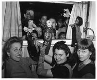 Members of the Art Education Club perform with puppets.