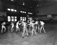 A group of students boxing in the gym.