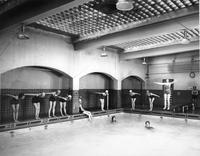 A group of female students at the Webster Hall Pool for class.