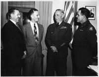 A photo of four men, two in R.O.T.C. uniform.