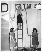 Three women decorating for a fundraising event.