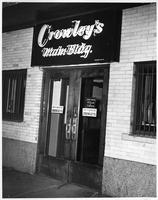 A photo of the front entrance to Crowley's Department Store's main building.