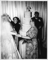 A bridal party at Crowley's Department Store, complete with a bride in her dress and a six-foot-tall wedding cake.