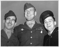 Three veterans pose for a photo.