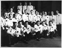 The Men's Glee Club poses for a portrait.