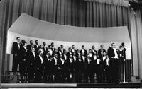 A photo post card of the Men's Glee Club, postmarked 1964.