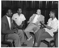 Kenneth Bateman (third left), former University Office of Education exchange specialist and member of the Wayne faculty, listens to an accounting of Ethiopian education problems from (left to right) Araya Johannes, Hailu Dargue, and Taye Reta. (far right).