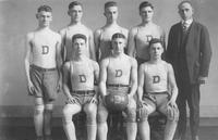 A portrait of the 1918-19 basketball team. Detroit Junior College. Back Row: Rosenzeig, Atliviack, Walmoth, Donnely, D.L. Holmes. Front: Davidow, Blatt (Captain), McMillan.
