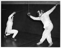 Two fencers spar.